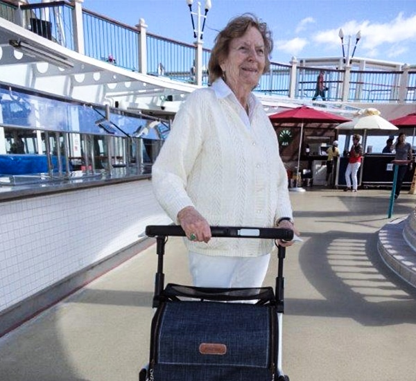 Lady talking a Rollz Flex stable rollator on a cruise ship