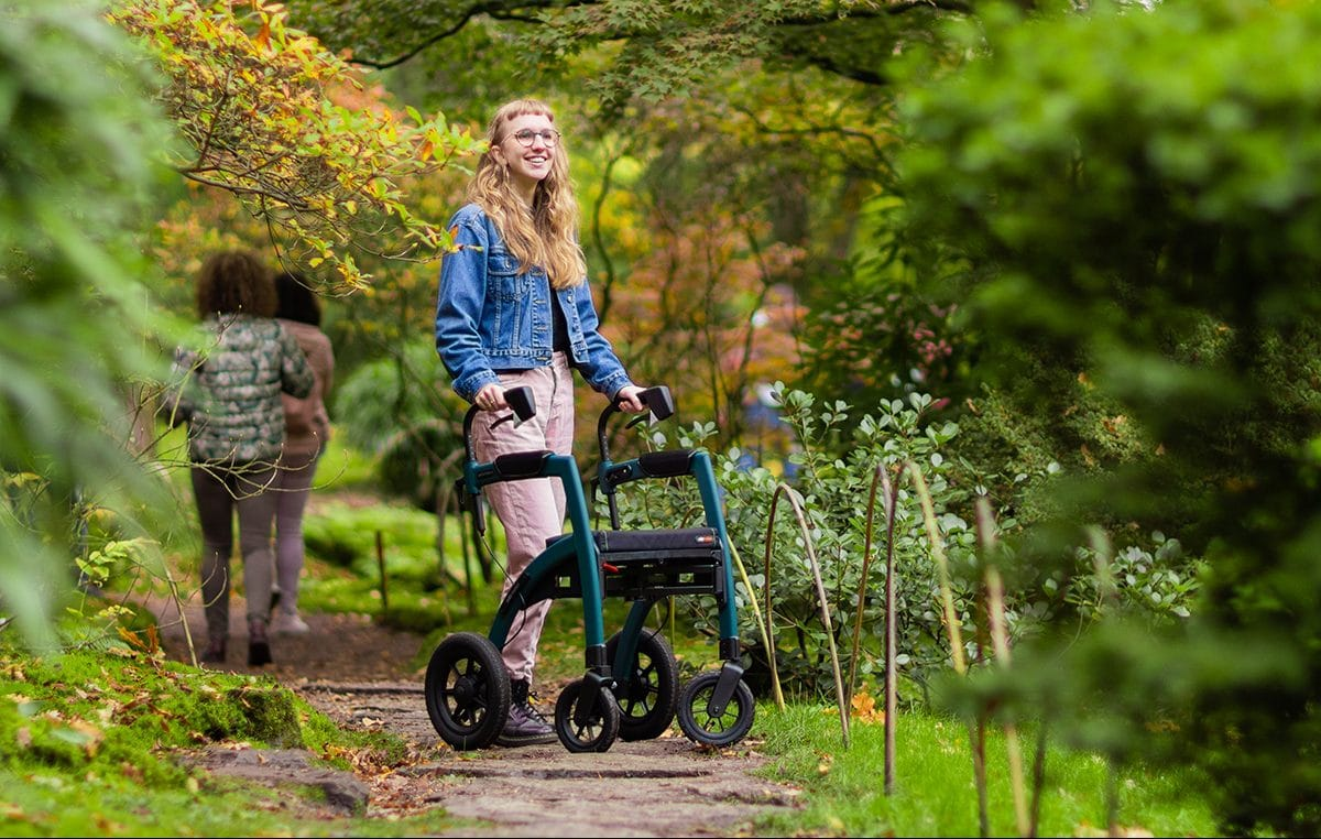 Young girl visiting a museum with a rollator with air tyres