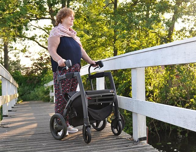 Walking with a Rollz Motion walker over a bridge